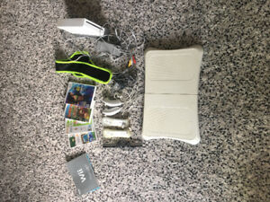 Wii Console + Accesories/Games