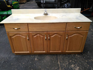 Oak Vanity with marble top and tap