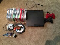 Play station 3 with 22 games and 2 controllers