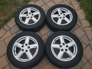 2 sets of tires and rims: 215/60/R16 and winter 205/65/R16