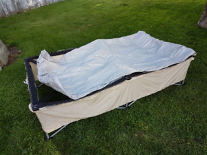 Like New Camping bed with air mattress, cover and pump.