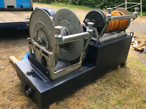 Two electric hose reels with hoses, roller fairleads, water tank