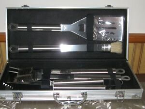 Never used 5 piece Stainless Steel BBQ set in case