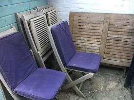 Garden table and six chairs and cushions