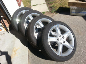set of 4 Lexus is 250-350 rims and tires 215/45/17