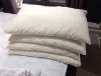 4 Excellent Feather Filled Pillows and 4Pillow protector.