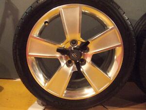 mags et pneus neufs 18 po. pour Mustang, peu vendre séparément