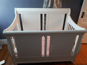 White Sleigh Style Crib with Adjustable Mattress Heights