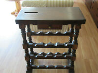 Beautiful occasional heavy wood table - will store wine bottles