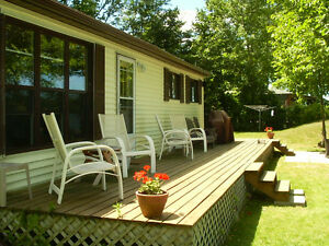 Beautiful Cottage on excellent lot.