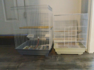 Two small bird cages