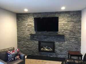 Looking to stone your fireplace? Skilled Stone Mason Available