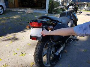 2010 Buell Blast.  5000 km.  Very clean. Soft saddlebags added