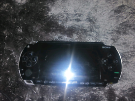 Psp comes with case and 1 game