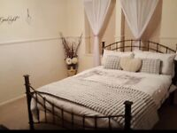Double iron bed.