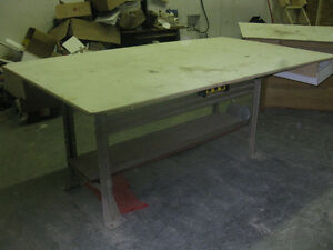 3 wooden work benches
