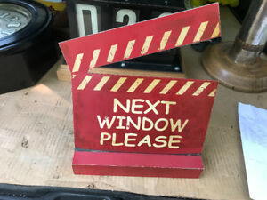 """NEXT WINDOW PLEASE"" / ""CAST MEMBERS ONLY"" METAL MOVIE SIGN"