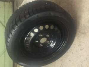 winter tires on rims. 5 bolt. came off a honda civic