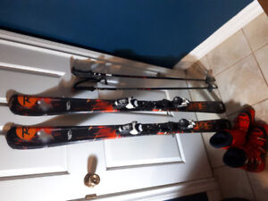 Child's downhill skis, poles, and boots.