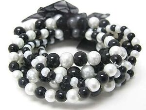 7 LINE BLACK AND WHITE GLASS FAUX PEARL RIBBON STRETCH BRACELET