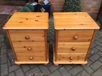 A PAIR OF SOLID PINE BEDSIDE CUPBOARDS