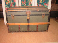 Antique wood trunk on casters. With orig. tray.