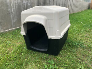 Large dog house for sale.