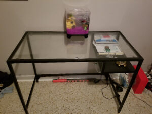 Glass desk with book holder.