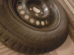 SNOW TIRES BRAND NEW  MOUNTED ON RIMS 14 INCH