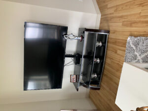 Glass and wood tv stand with swivel mount attached