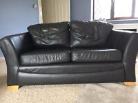 Dark brown leather two seater settee