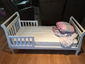 Toddler Bed with mattress and various bedding