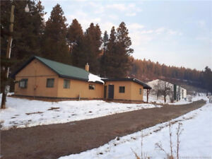 one level fixer upper with oversize shop on 5 acres