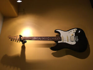 Aria electric guitar with gig bag and cool tap switch