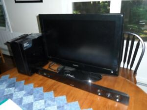 Samsung 32in.tv with soundbar and wireless subwoofer