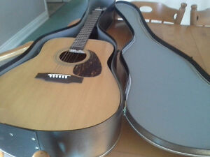 Yamaha Eterna accustic guitar with hard shell case