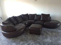 Brown corner sofa with matching foot stool