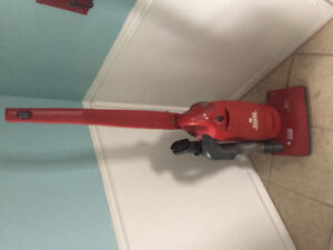 Sanitaire Commercial upright vacuum.