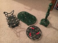Cast iron egg holder, 2 x trivet things and kitchen roll holder