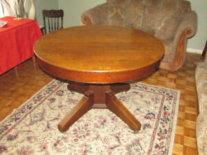 Antique Round Oak Table with 5 leaves pulls out to 8 feet