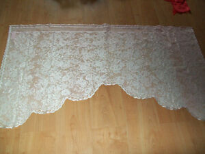 Lace curtains and tablecloth