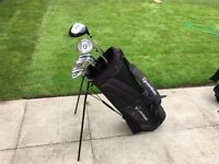 Full set of graphite irons golf clubs, Taylor made bag, driver, 3 wood & 5 wood. Very good condition