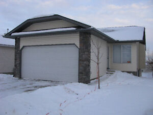 Main Floor-Okotoks-includes utilities and Double Garage-REDUCED