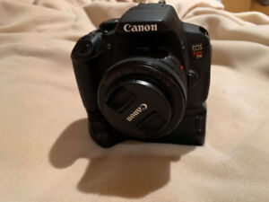 Canon t5i with 5 batteries + Battery Grip (BODY ONLY)