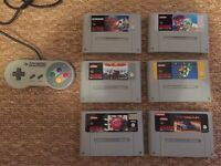 Super Mario World plus 5 other SNES games and a controller