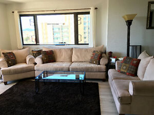 Living room set of beige couches in good condition