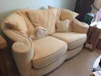 Two seater sofa and footrest