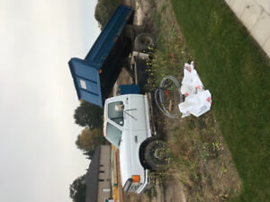 1989 Ford F450 Superduty Dumptruck with fold down sides.