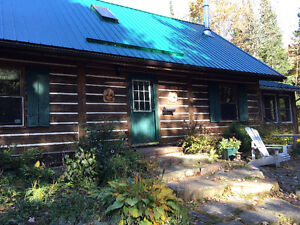 LOG HOME WITH 15 ACRES