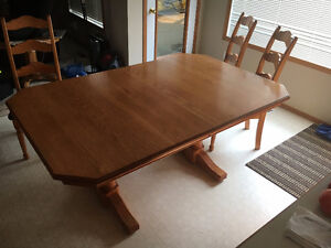 Sold oak table and 4 chairs